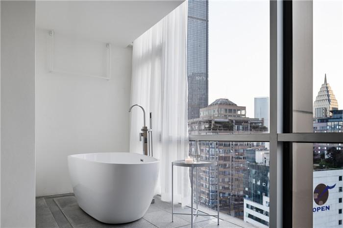 郑州勃朗设计分享简约朴质的白居精品酒店客房浴缸设计方案