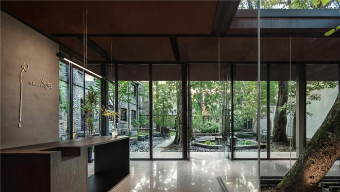 酒店大堂接待台设计-集书店、咖啡、美术馆于一体的精品酒店设计方案
