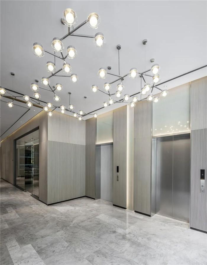 酒店客房电梯厅设计-经久不衰的现代简约风CRYSTAL ORANGE酒店设计